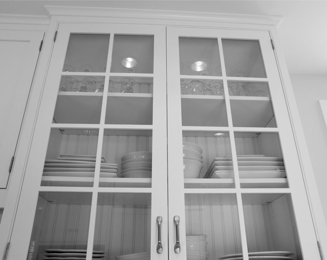 Custom-designed glass fronted cabinets