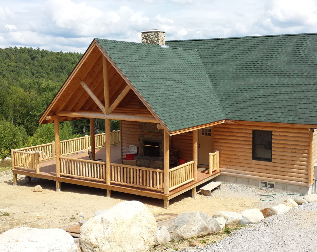 Log style home with wraparound porch